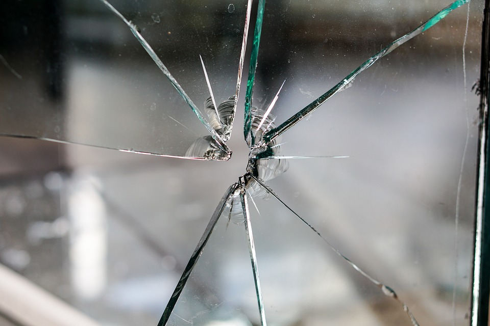 cracked broken glass property management guide
